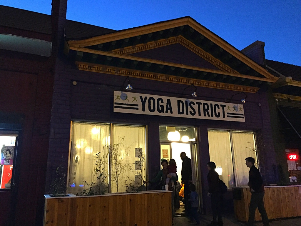 Mourners and supporters gather for meditation and prayers inside the Yoga District studio tonight before a scheduled candlelight vigil ...