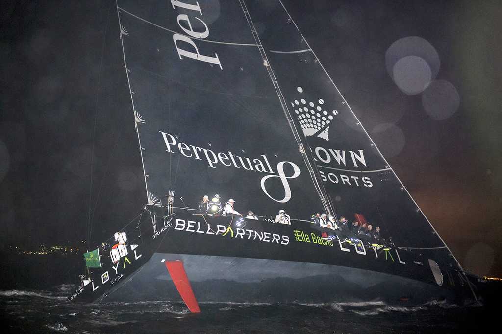 In this photo provided by Rolex the Supermaxi Perpetual Loyal  crosses the finish to take line honors in the Sydney Hobart yacht race ...