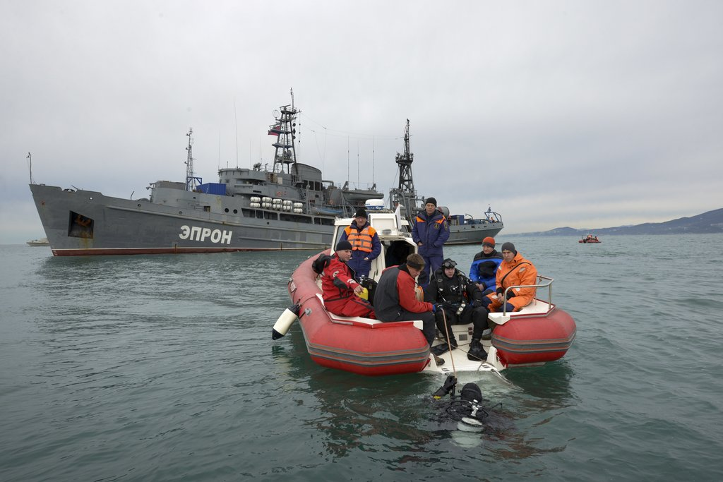Russian Emergency Ministry divers prepare to search fragments of a plane in the Black Sea, outside Sochi, Russia, Tuesday, Dec. 27, 201...