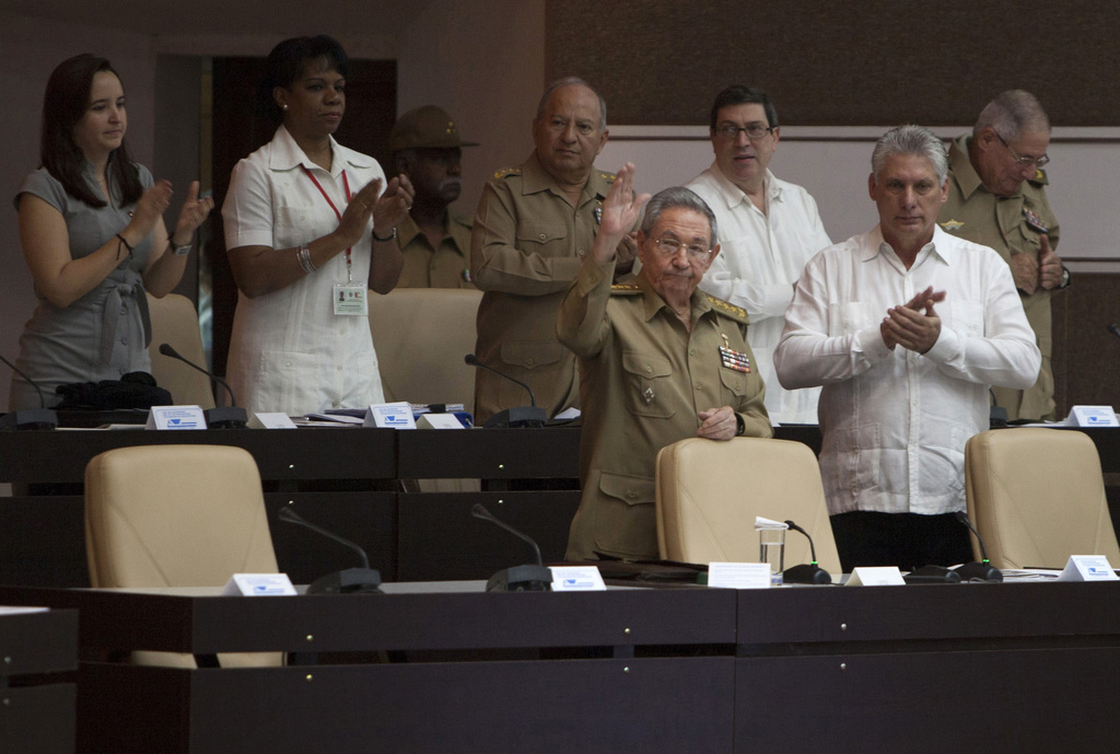 Cuba's President Raul Castro, front left, and Vice President Miguel Diaz-Canel, front right, attend the biannual legislative session at...