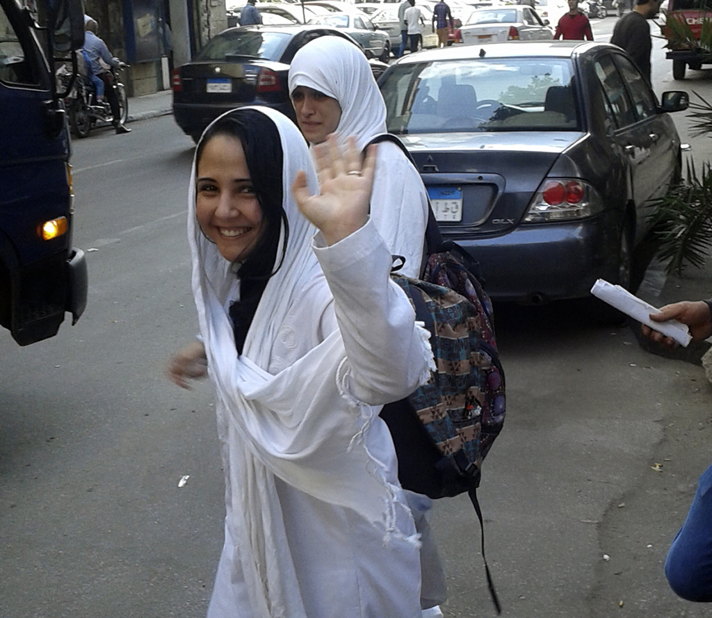In this photo provided by Basel Hijawi, taken in 2015, American citizen Aya Hijazi waves as she leaves a court in Cairo after hearing. ...