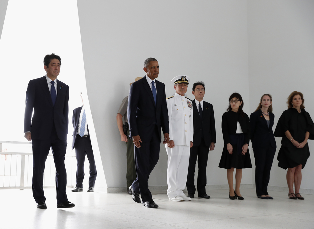 President Barack Obama and Japanese Prime Minister Shinzo Abe arrive to participate in a wreath laying ceremony at the USS Arizona Memo...