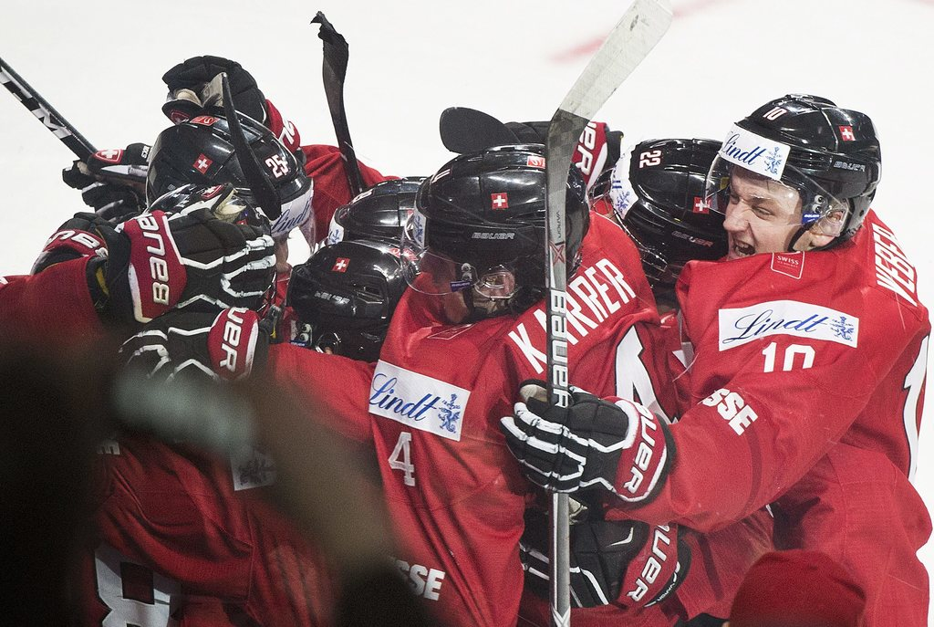 Team Switzerland players celebrate following their win over the Czech Republic in a preliminary round IIHF World Junior Championship ho...