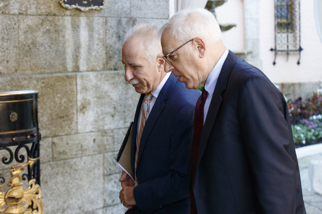Johns Hopkins Medicine CEO Dr. Paul Rothman, left, and Carlyle Group co-founder and co-CEO David Rubenstein arrive at Mar-a-Lago for me...