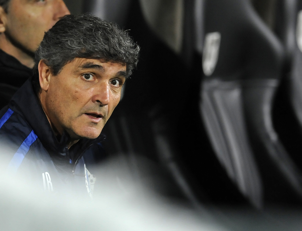 FILE - In this Thursday, Oct. 24, 2013 file photo,  Juande Ramos, Dnipro's coach at that time, watches from the bench during their Euro...