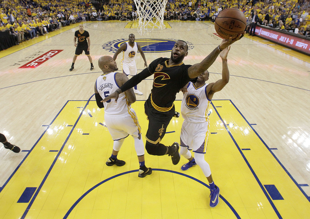 FILE - In this June 19, 2016 file photo, Cleveland Cavaliers forward LeBron James (23) shoots against the Golden State Warriors during ...