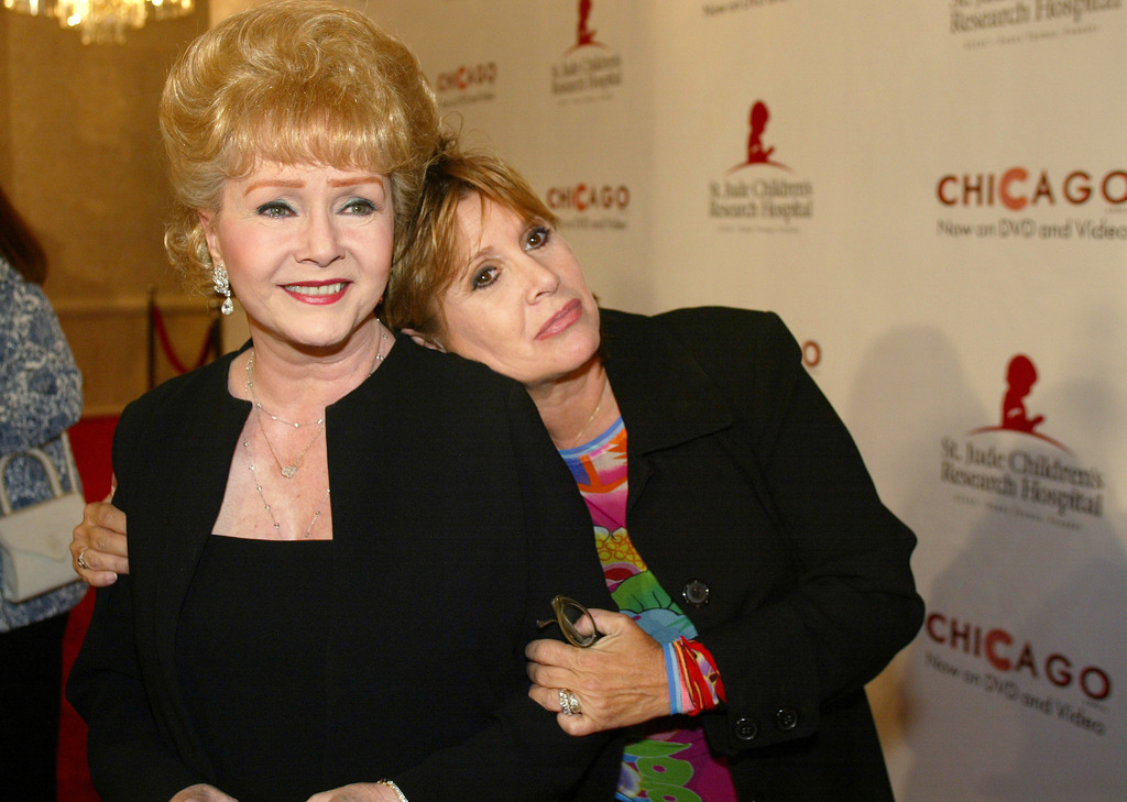 "FILE - In this Tuesday, Aug. 19, 2003 file photo, Debbie Reynolds and Carrie Fisher arrive at the ""Runway for Life"" Celebrity Fashion S..."
