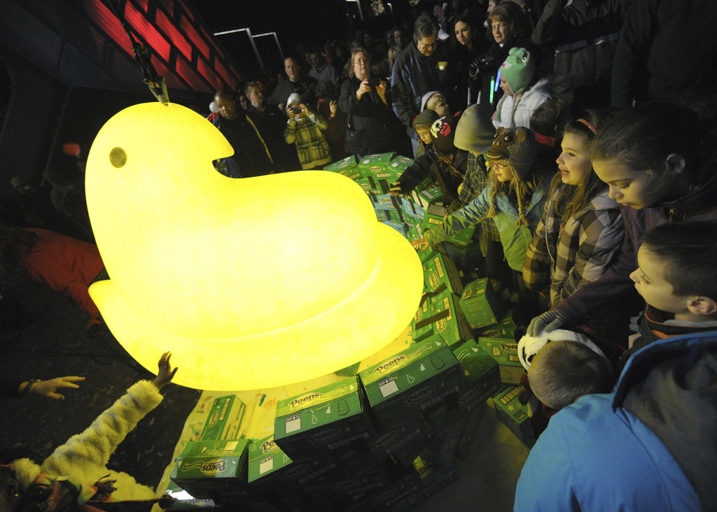 FILE - In this Saturday, Dec. 31, 2011, file photo, children gather around a large Peep after it was dropped during a New Year's Eve ce...