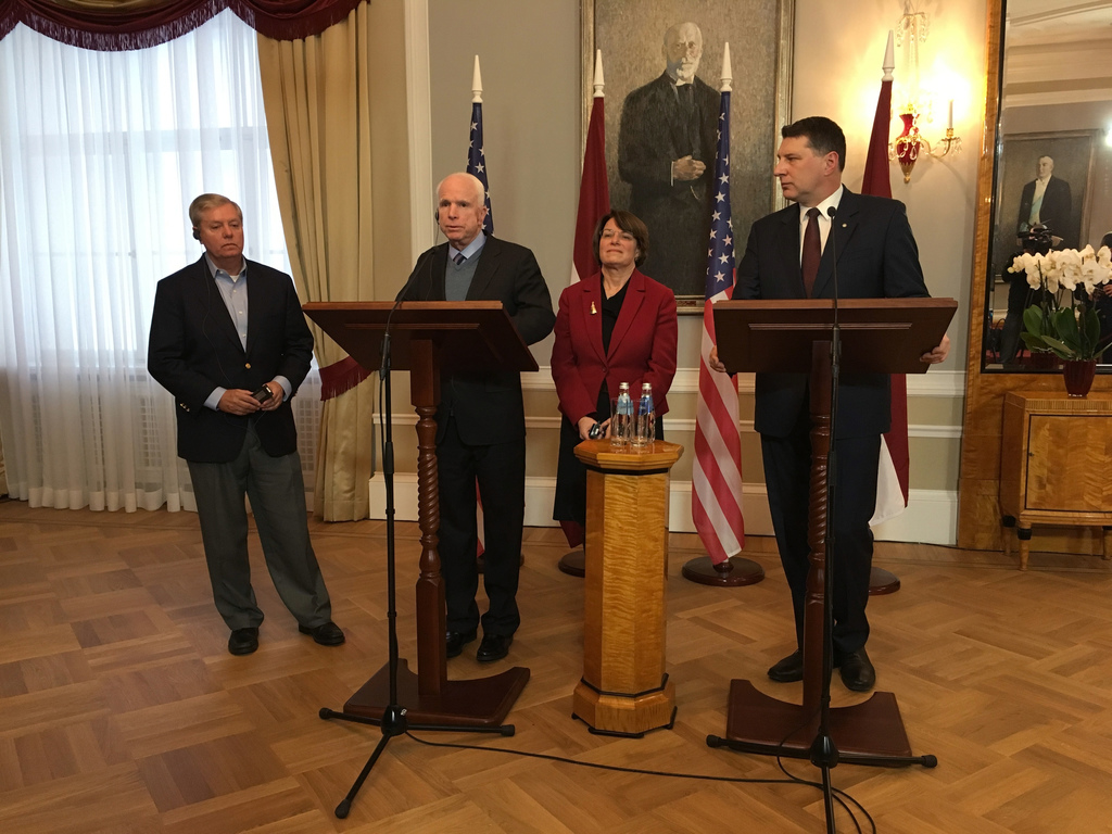 Latvian President Raimonds Vejonis, right, looks at  US Sen. John McCain centre left, during a press conference,  Wednesday, Dec. 28, 2...