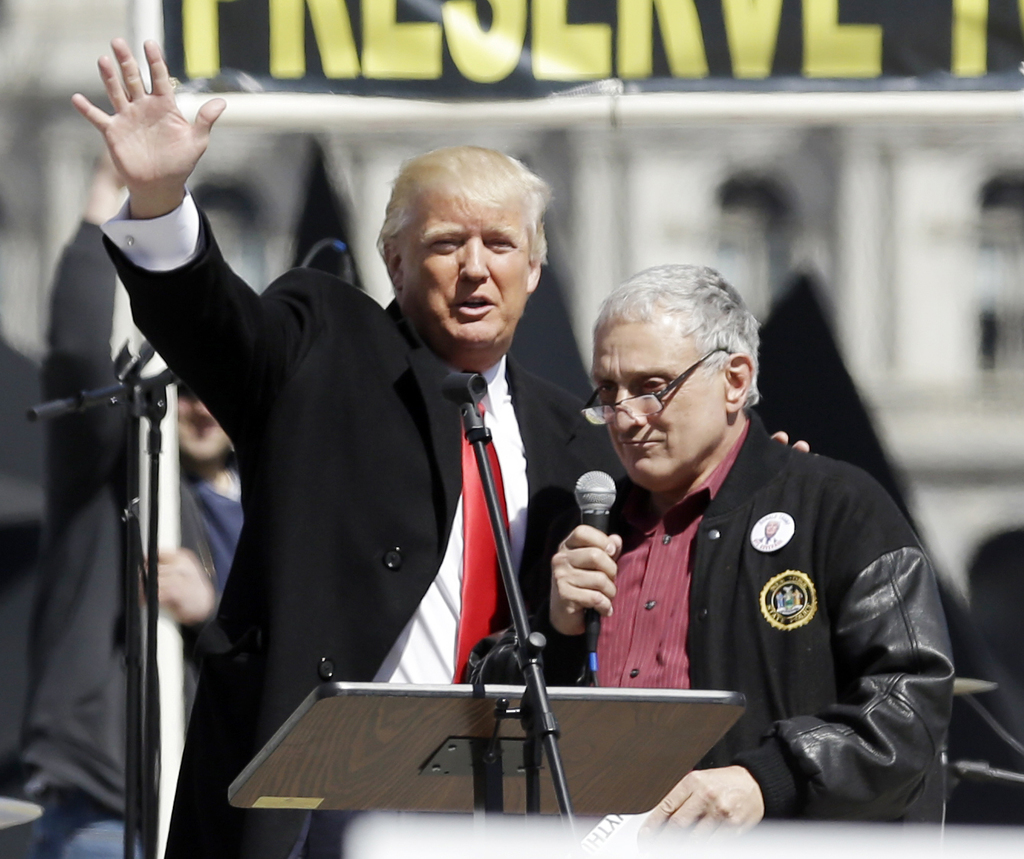 FILE - In this April 1, 2014, file photo, Donald Trump, left, is joined by Carl Paladino during a gun rights rally at the Empire State ...