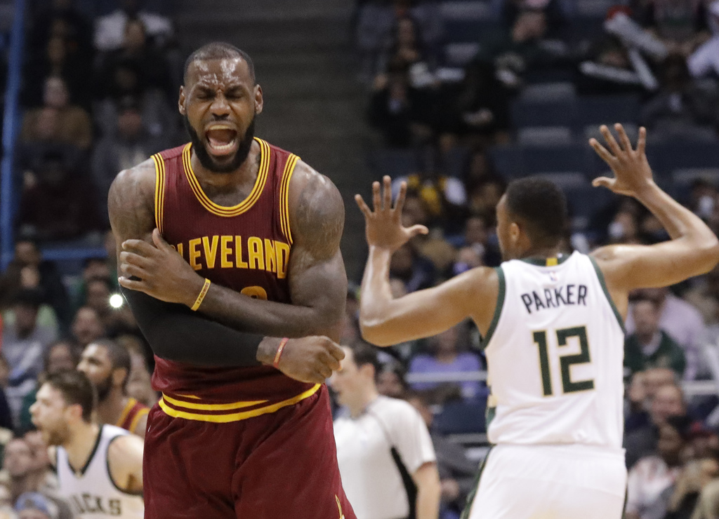FILE - In this Nov. 29, 2016 file photo, Cleveland Cavaliers' LeBron James reacts to no call being called on his shot during the second...