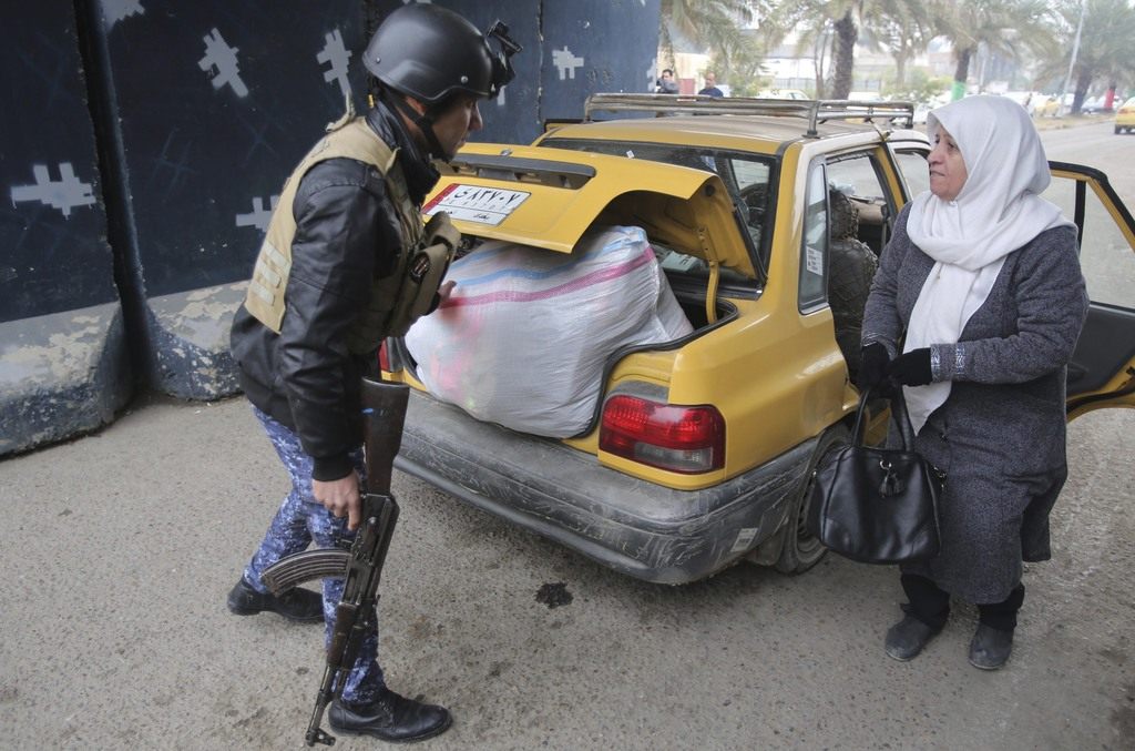 Iraqi security forces search cars in Baghdad's southwestern Saydiyah neighborhood a day after journalist Afrah Shawqi al-Qaisi was kidn...