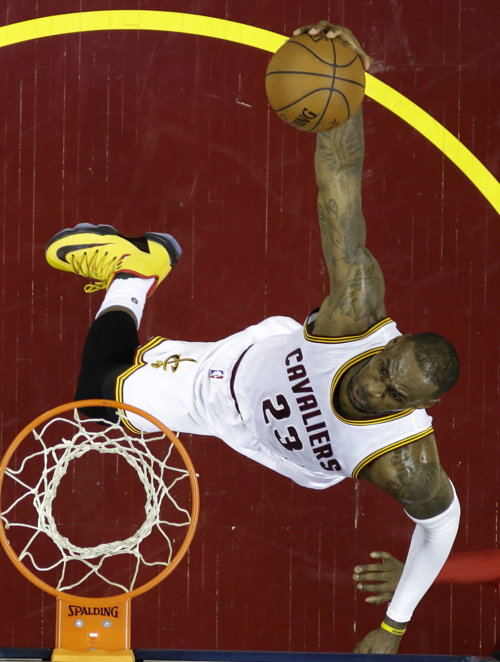 FILE - In this May 17, 2016 file photo, Cleveland Cavaliers' LeBron James dunks against the Toronto Raptors during the first half of Ga...