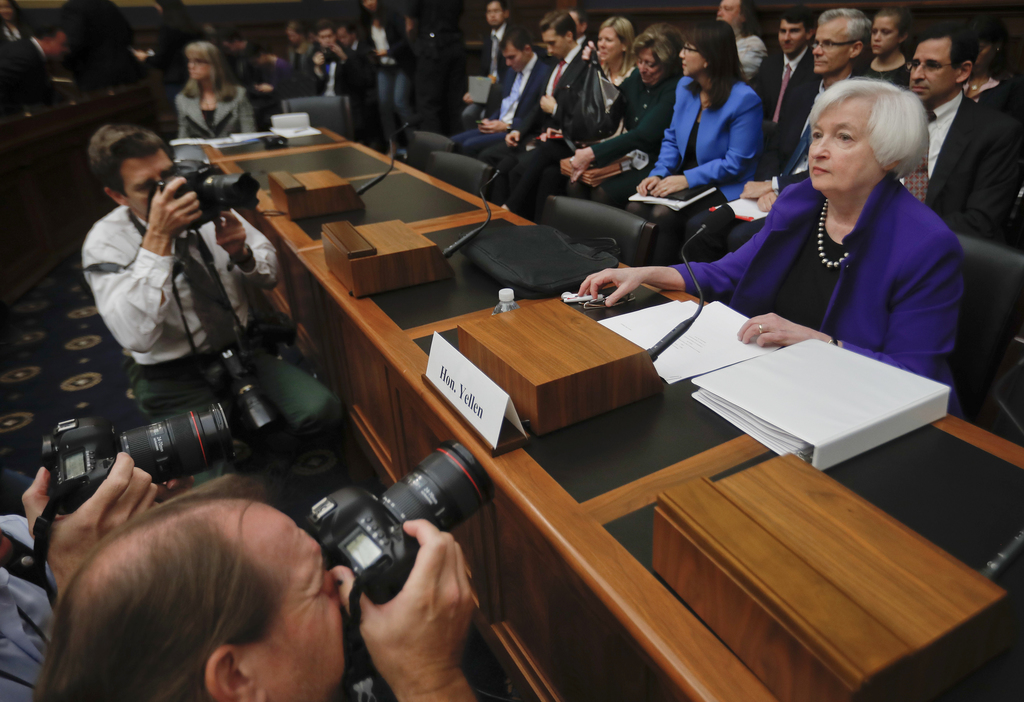 FILE - In this Wednesday, Sept. 28, 2016, file photo, Federal Reserve Board Chair Janet Yellen prepares to testify on Capitol Hill in W...
