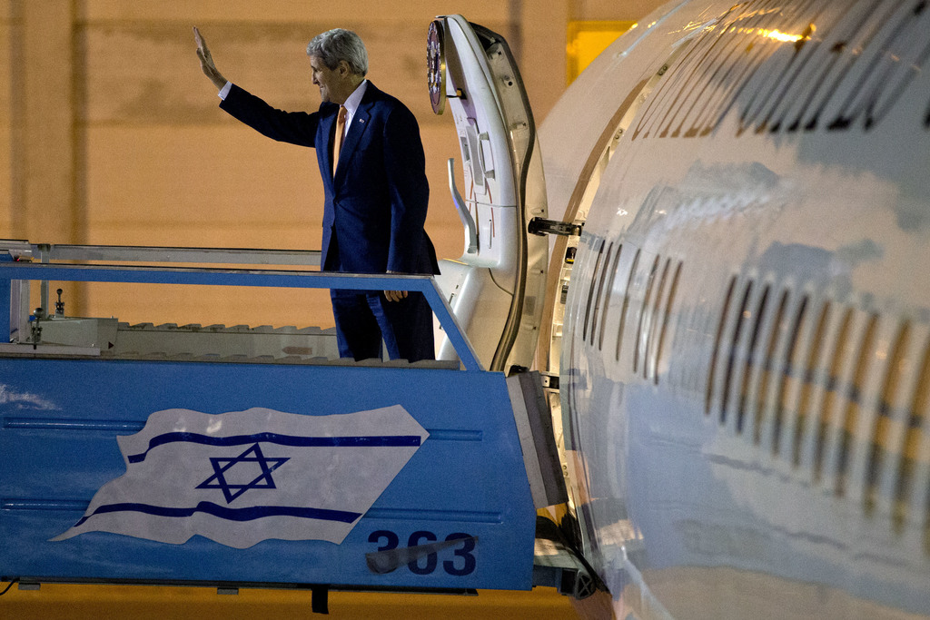 FILE -- In this Nov. 24, 2015 file photo, U.S. Secretary of State John Kerry waves as he boards the plane on departure from Israel afte...