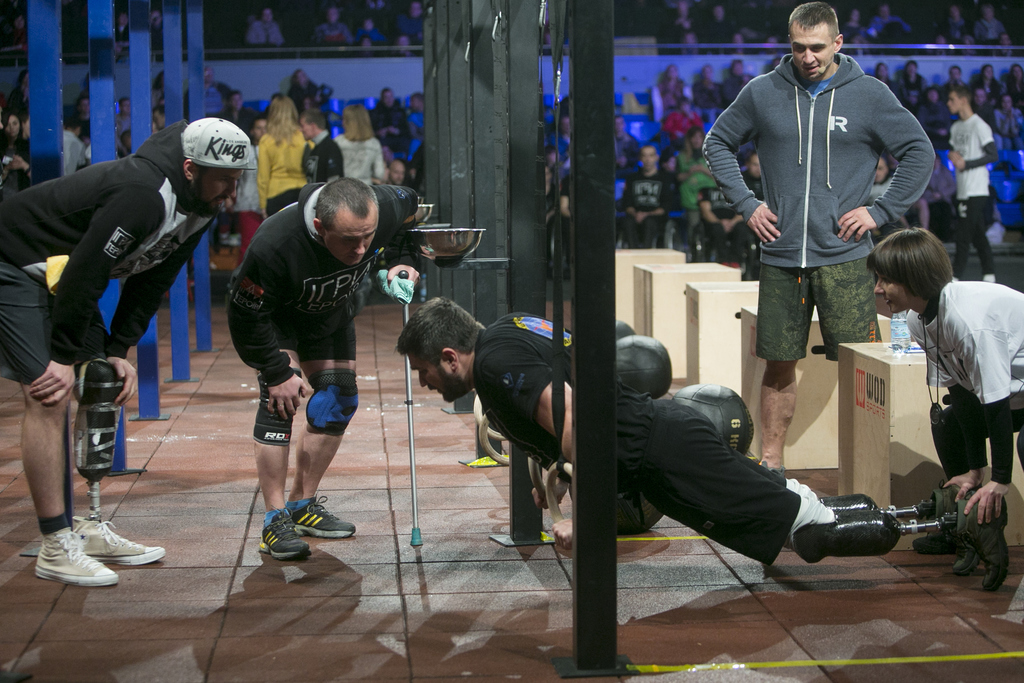 In this photo taken Saturday Dec.24, 2016, Lt. Volodymyr Kovalsky, 33, wearing leg prosthesis, competes in the Games of Heroes CrossFit...