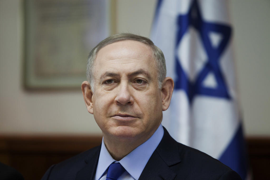 FILE -- In this Sunday, Dec. 25, 2016 file photo, Israeli Prime Minister Benjamin Netanyahu attends a weekly cabinet meeting in Jerusal...