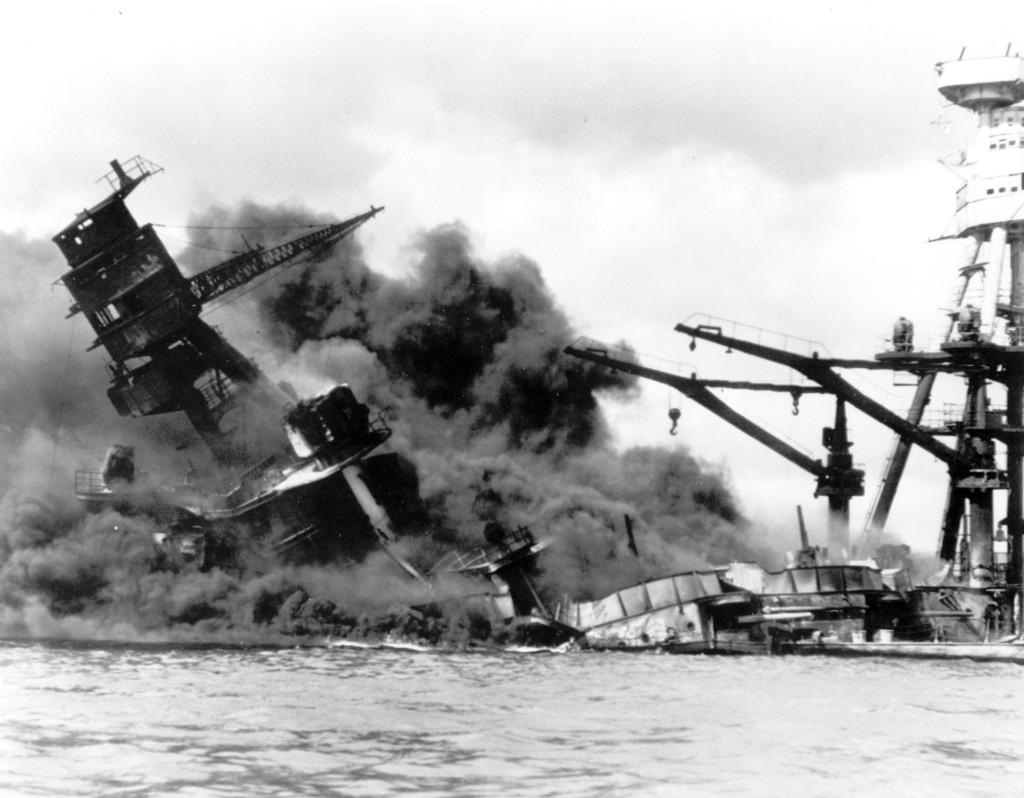 FILE - In this Dec. 7, 19041 file photo, the battleship USS Arizona belches smoke as it topples over into the sea during a Japanese sur...
