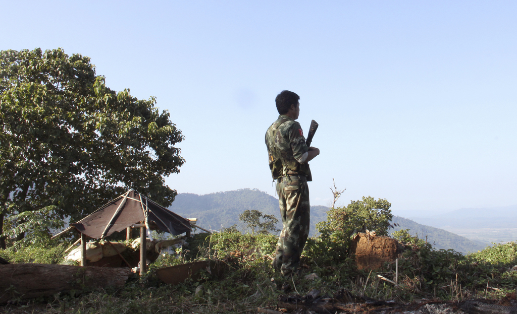 In this Nov. 30, 2016 photo, a Kachin Independence Army (KIA) soldier patrols at the front line near Laiza, the headquarters of the KIA...