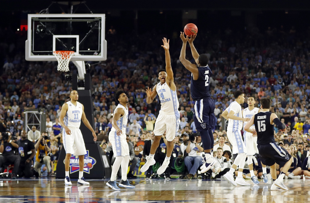 FILE - In this April 4, 2016, file photo, Villanova's Kris Jenkins makes the game-winning 3-point shot during the NCAA Final Four tourn...