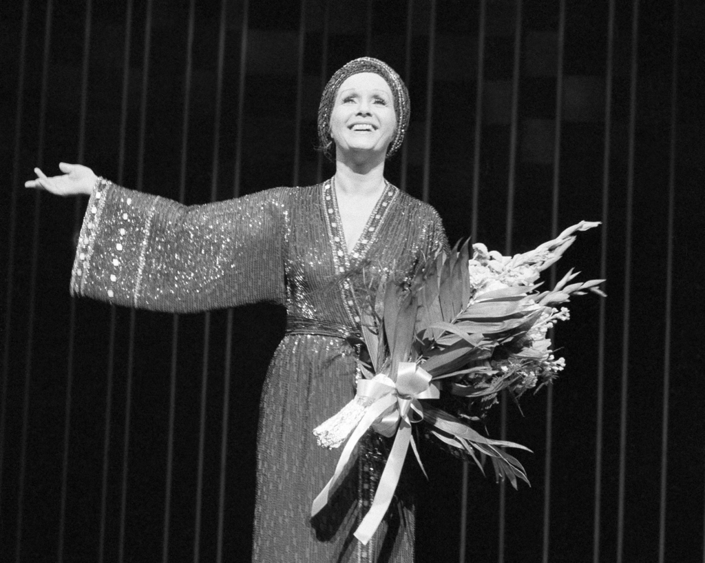 "FILE- In this March 8, 1983, file photo, actress Debbie Reynolds returns for a curtain call after a performance of ""Woman of the Year"" ..."