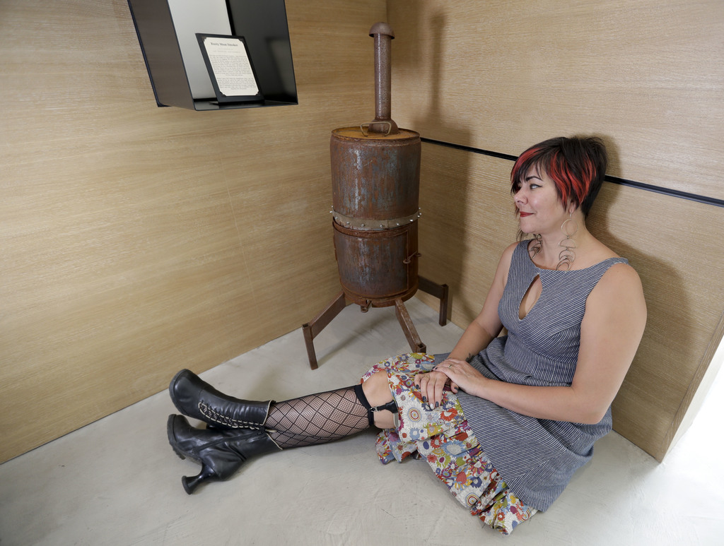 Amber Clisura poses for a picture next to the meat smoker she donated to the new Museum of Broken Relationships Wednesday, Dec. 28, 201...