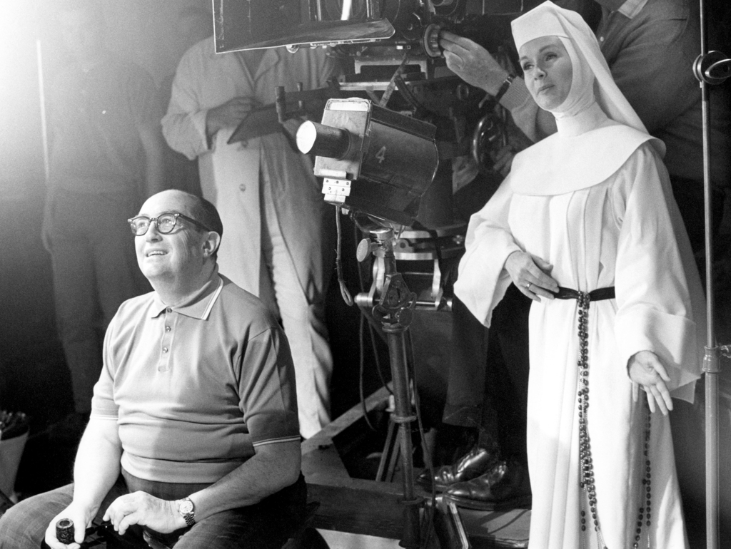 FILE- In this Nov. 15, 1965, file photo, Debbie Reynolds, dressed as nun for her role as a singing nun in the MGM picture of that name,...