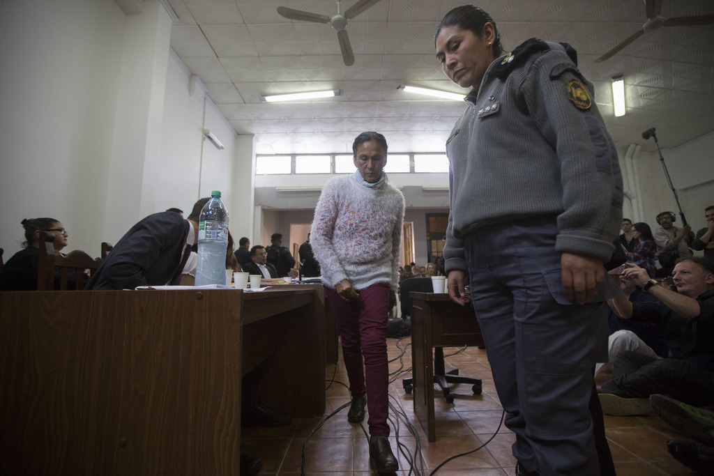 Activist Milagro Sala walks inside the courtroom before being given a guilty verdict in San Salvador de Jujuy, in the northern Argentin...