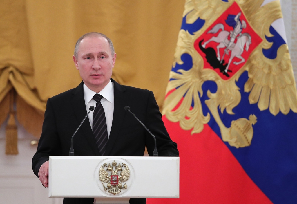 Russian President Vladimir Putin speaks during a New Year reception in the Kremlin in Moscow, Russia, Wednesday, Dec. 28, 2016. (Mikhai...