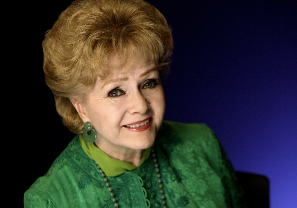 FILE - This Oct. 14, 2011 file photo shows actress Debbie Reynolds posing for a portrait in New York. Reynolds, star of the 1952 classi...