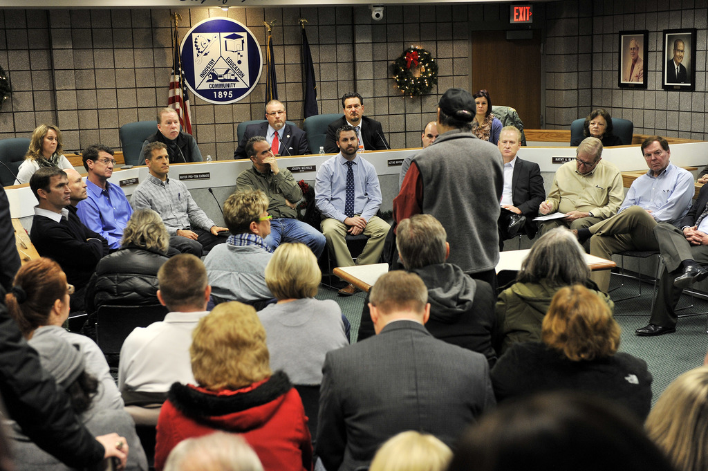 In this Monday, Dec. 26, 2016 photo a panel of engineers and public officials listen to business owner Anthony Michael talk about the d...