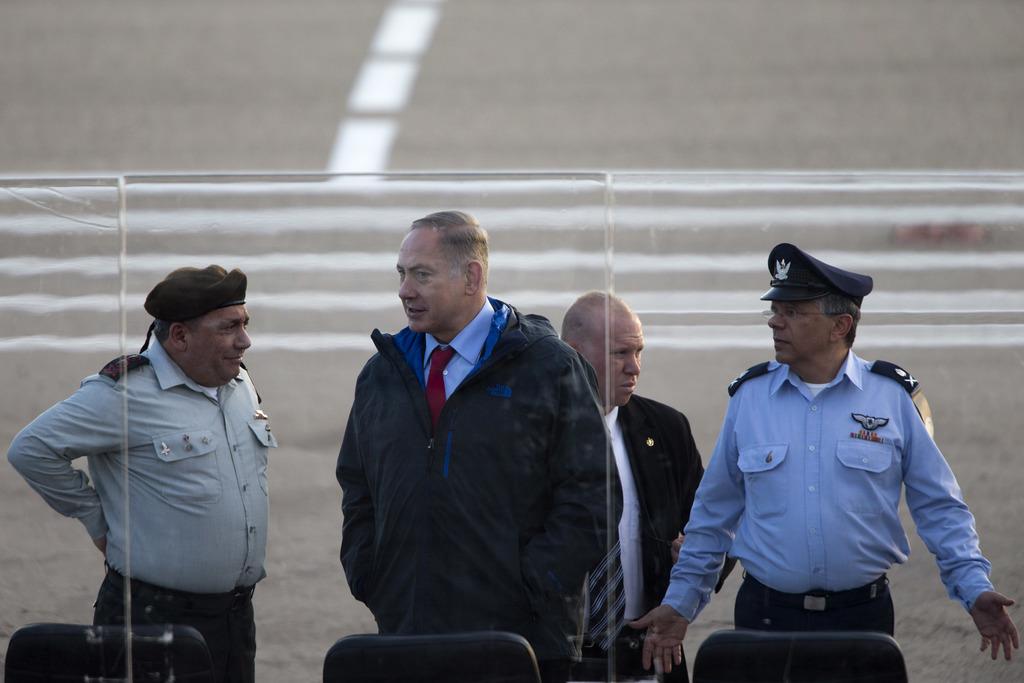 Israel's Prime Minister Benjamin Netanyahu, center, Israel's Chief of Staff Lt. Gen. Gadi Eizenkot, left, and Israel's air force comman...