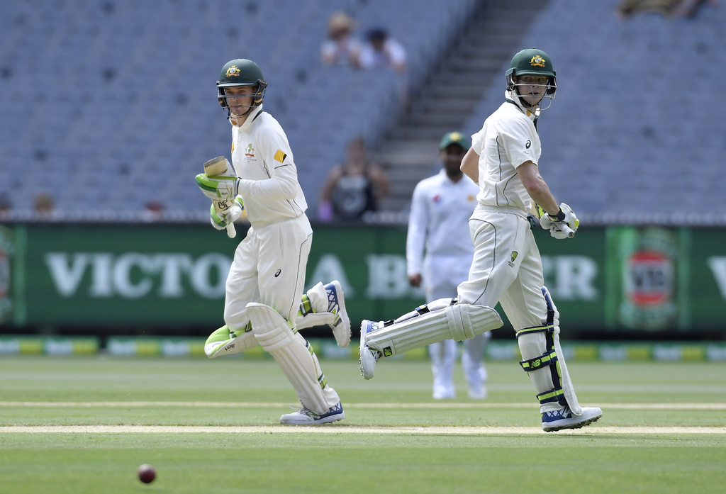 Australia's Peter Handscomb, left, and Australian captain Steven Smith run between wickers against Pakistan on the fourth day of their ...