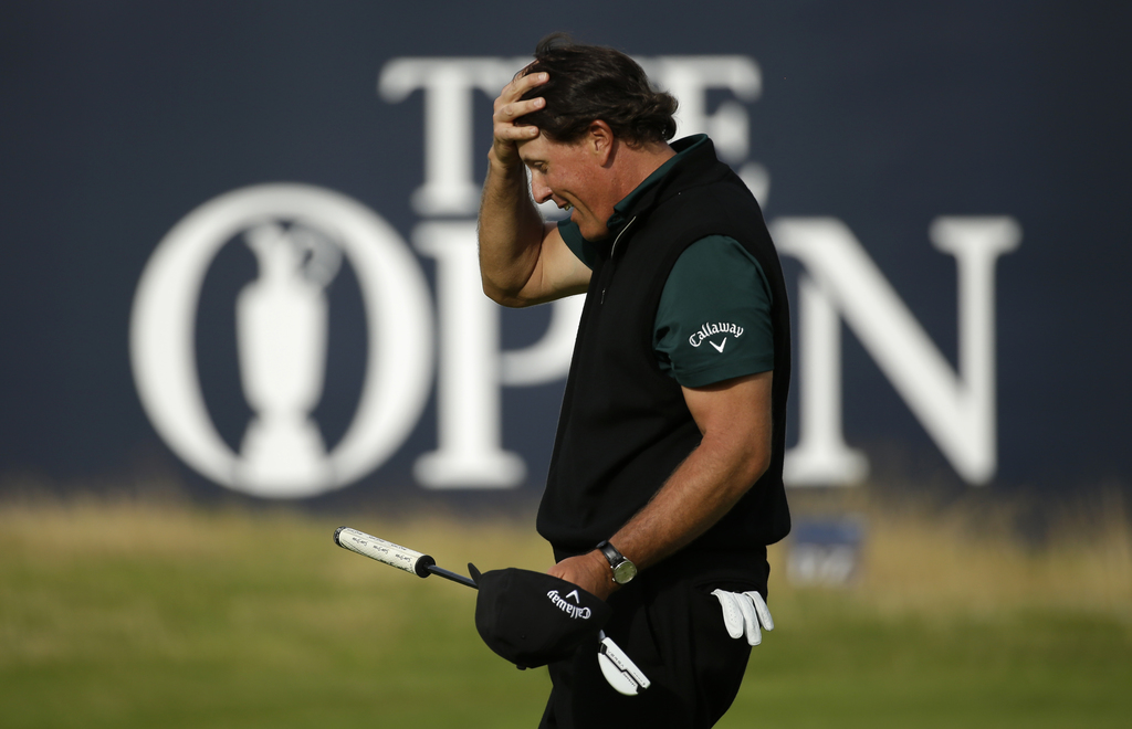 FILE - In a Thursday, July 14, 2016 file photo, Phil Mickelson of the United States reacts after missing a birdie putt on the 18th gree...