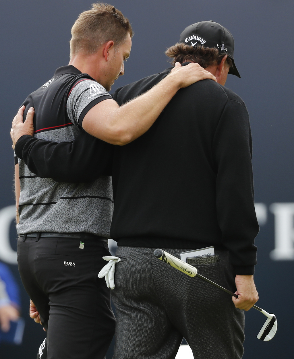 FILE - In this July 17, 2016, file photo, Henrik Stenson, left, of Sweden, and Phil Mickelson, of the United States, embrace as they wa...