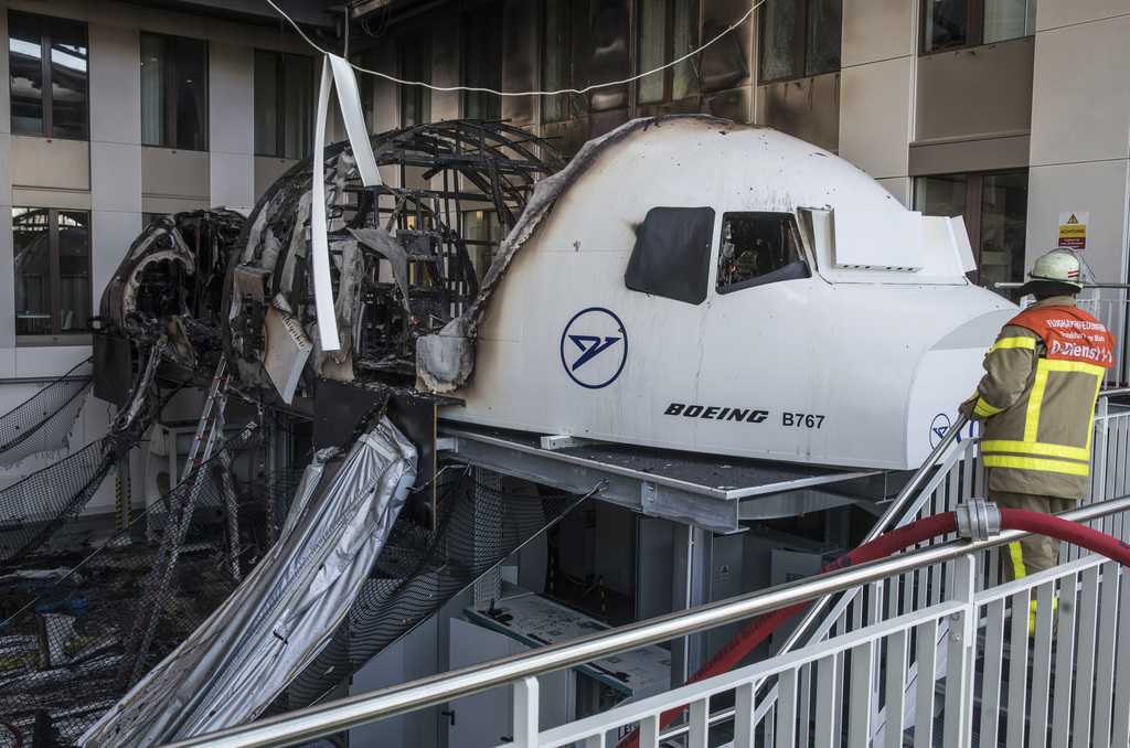 A firefighter stands in the office of Condor airlines next to a burned out flight simulator in the airport in Frankfurt am Main, German...