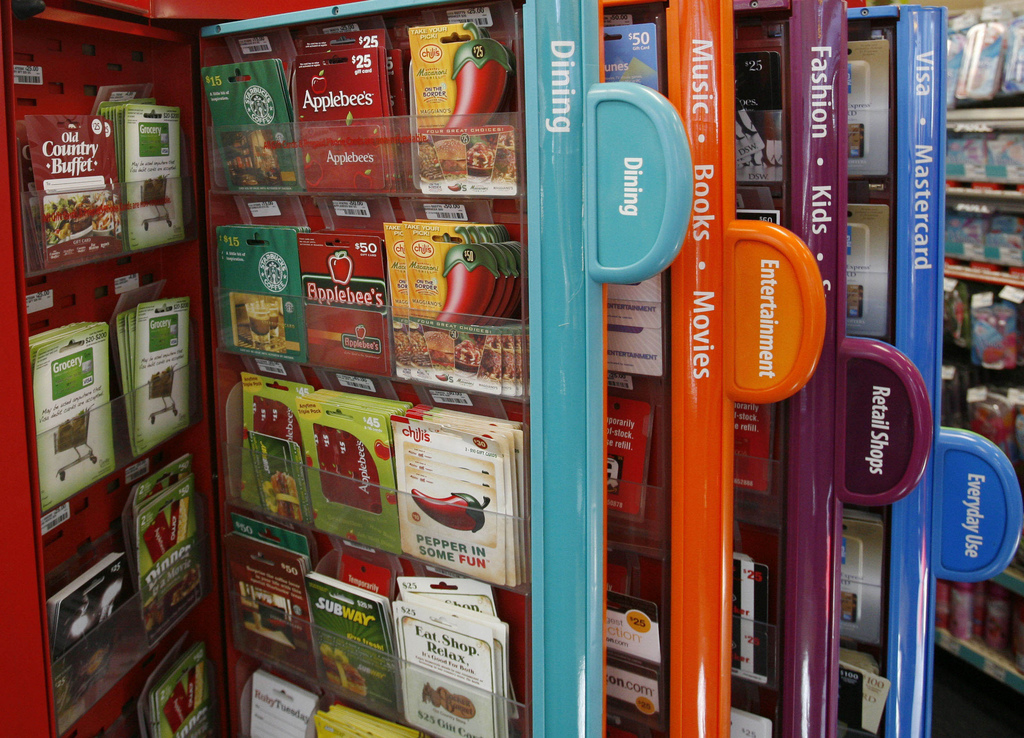 FILE- This Dec. 22, 2009, file photo shows a gift card kiosk in New York. If you know you won't be using a gift card, you can sell them...