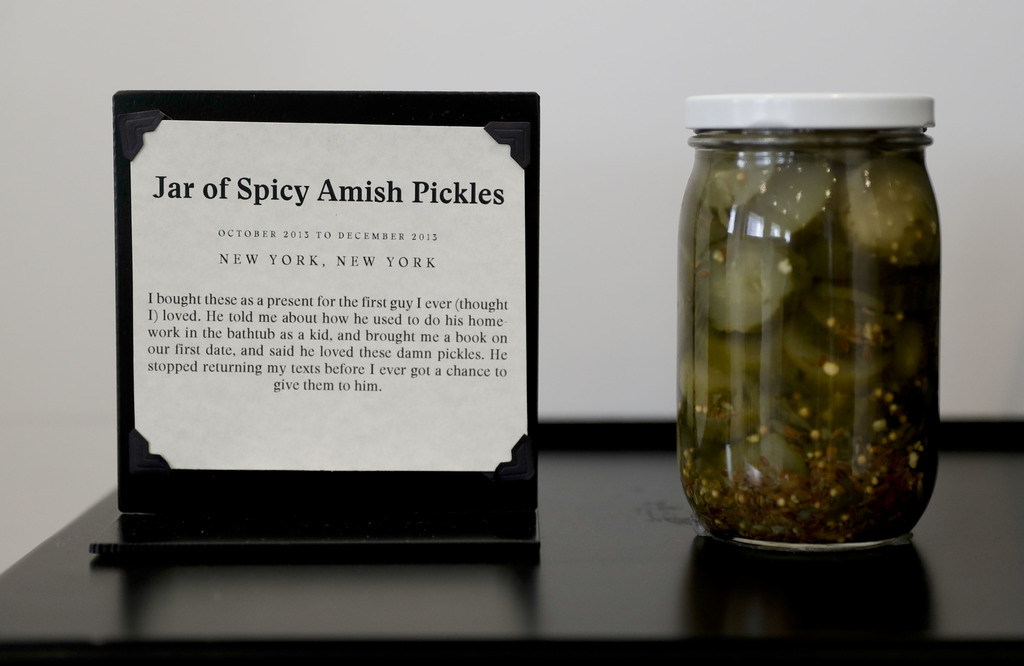 A jar of pickles purchased for a first love is displayed at the new Museum of Broken Relationships Wednesday, Dec. 28, 2016 in Los Ange...