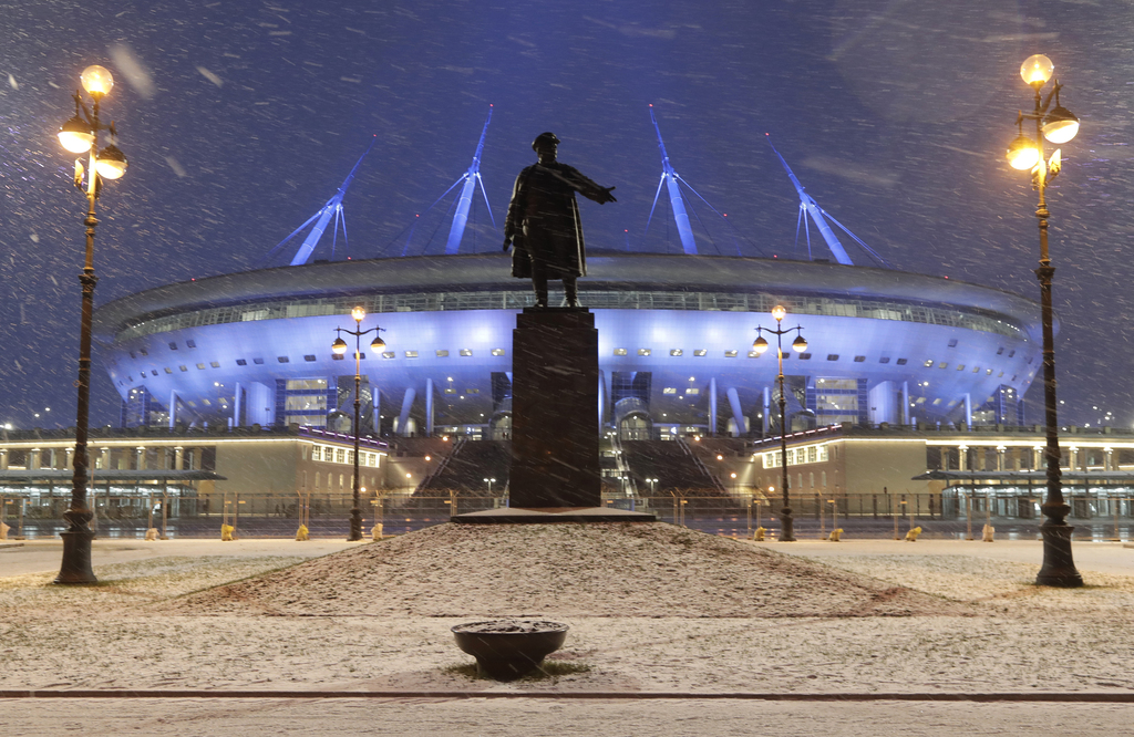 A sculpture of one of Bolshevik's leaders Sergei Kirov stands in front of soccer stadium, which is under construction on Krestovsky Isl...