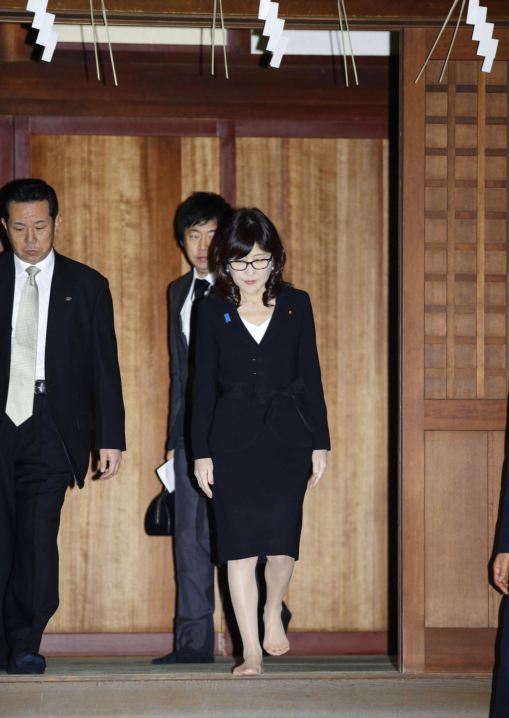 Japan's Defense Minister Tomomi Inada, front right, visits Yasukuni Shrine, which honors Japanese war dead, in Tokyo Thursday, Dec. 29,...