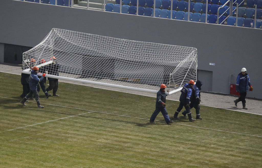 Workers carry a goal of a soccer stadium, which is under construction on Krestovsky Island and which will host some of 2018 World Cup s...