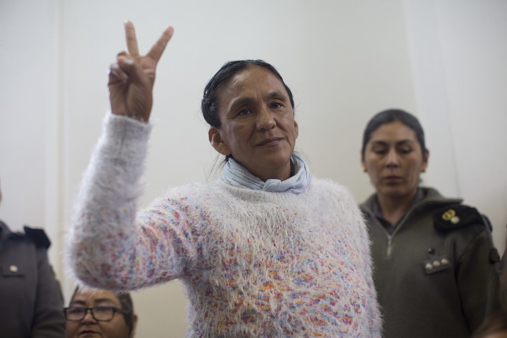 Activist Milagro Sala flashes the victory sign before being given a guilty verdict at a courtroom in San Salvador de Jujuy, in the nort...