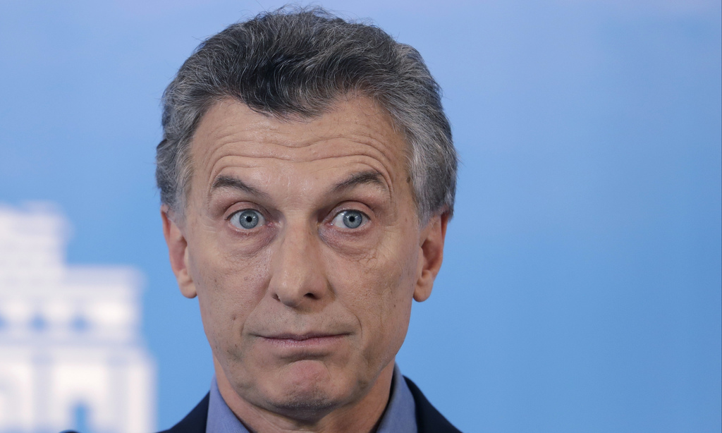 FILE - In this Sept. 28, 2016 file photo, Argentine President Mauricio Macri pauses as he talks about new poverty numbers released by t...