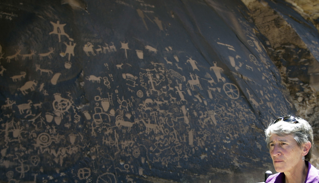 FILE - This July 14, 2016, file photo, the Newspaper Rock featuring a rock panel of petroglyphs in the Indian Creek Area is shown to U....
