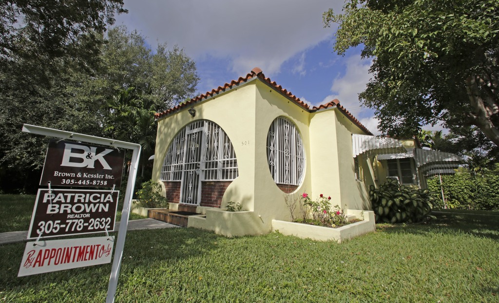 This Tuesday, Dec. 6, 2016, photo shows a house for sale in Coral Gables, Fla. On Thursday, Dec. 29, 2016, Freddie Mac reports on the w...