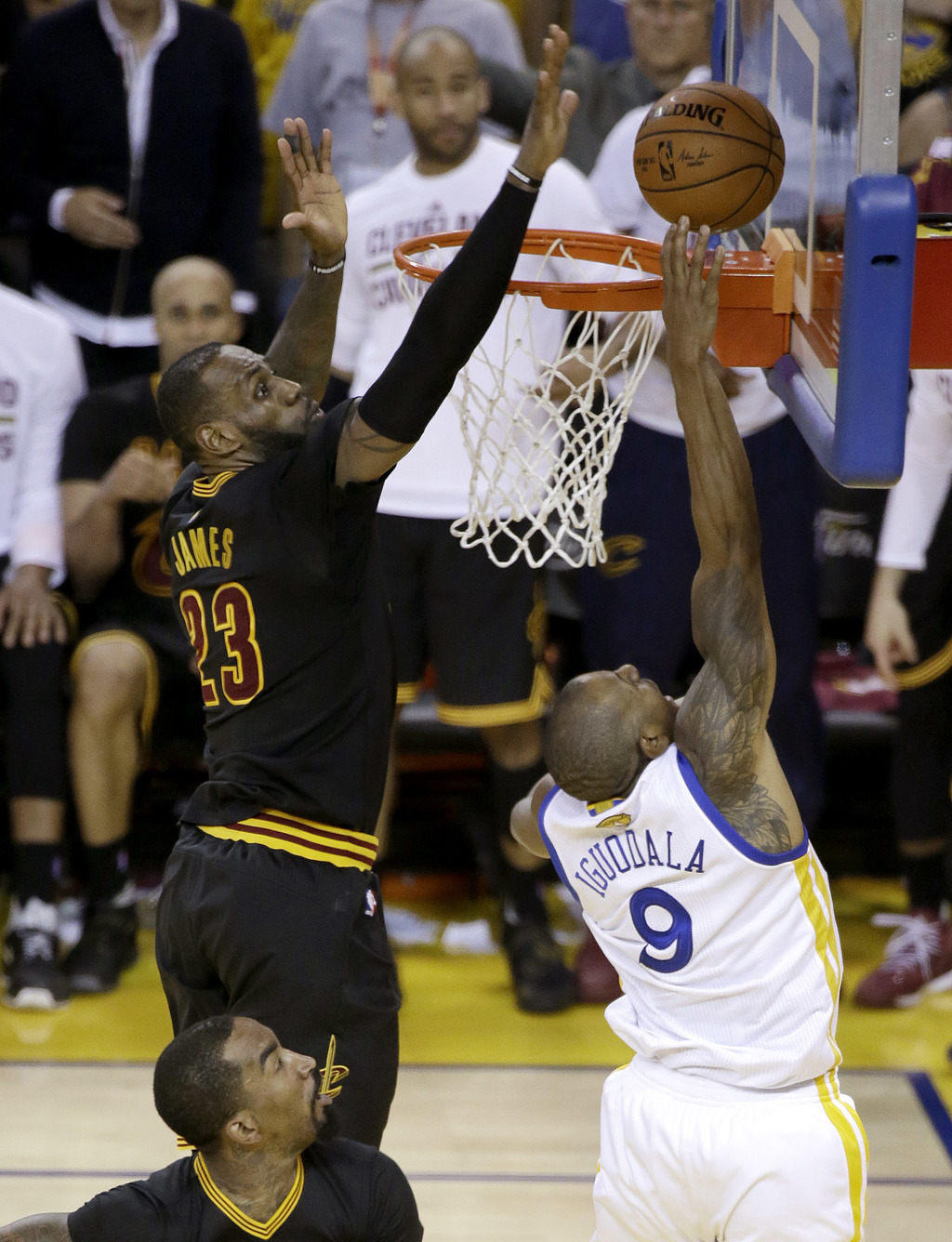 In this Sunday, June 19, 2016 photo, Cleveland Cavaliers forward LeBron James (23) blocks a shot by Golden State Warriors forward Andre...
