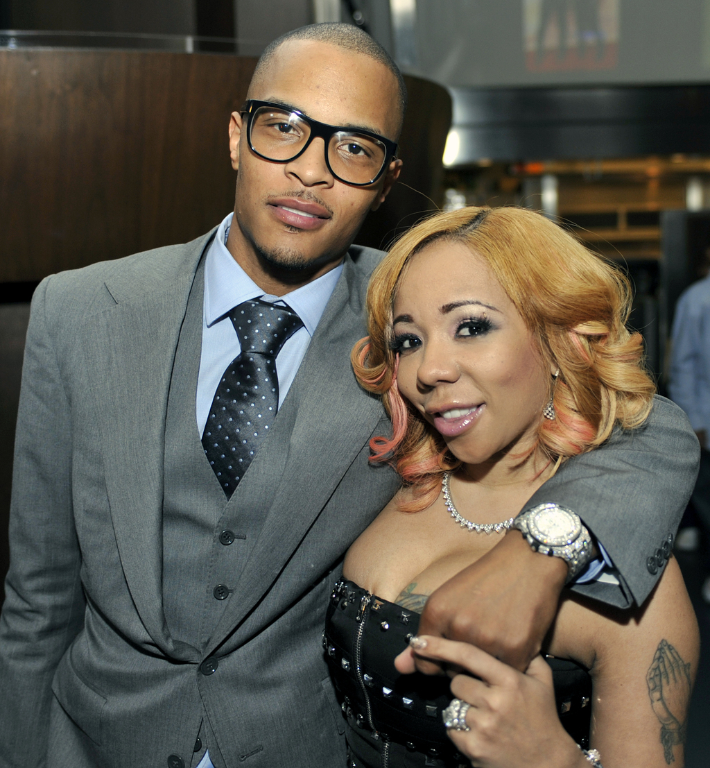 """FILE - In this Oct. 3, 2010 file photo, Grammy award winning artist Clifford """"TI"""" Harris, left, poses for media with his wife Tameka """"T..."""