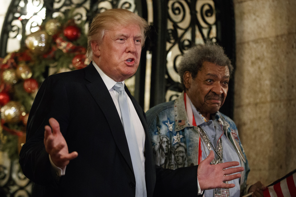 President-elect Donald Trump, left, stands with boxing promoter Don King as he speaks to reporters at Mar-a-Lago, Wednesday, Dec. 28, 2...