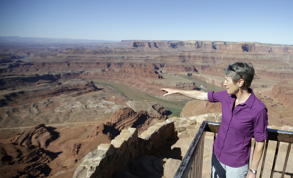 FILE - This July 14, 2016, file photo, U.S. Interior Secretary Sally Jewell looks from Dead Horse Point, near Moab, Utah, during a tour...