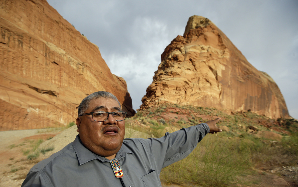 FILE - This June 21, 2016, file photo, Malcolm Lehi, a Ute Mountain Tribal Commissioner points to a rock formation near Blanding, Utah....